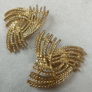 Sarah Coventry clip on gold colored earrings.